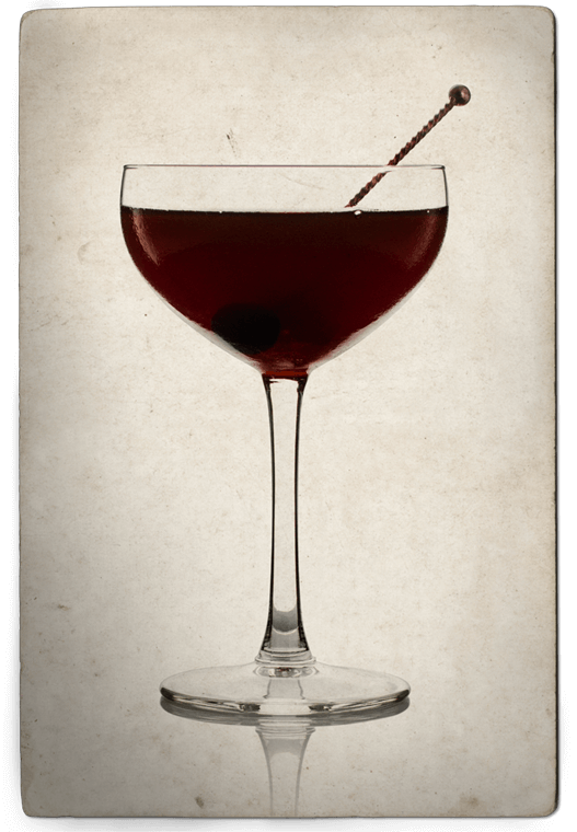 Cantante Cocktail in Coupe Glass with Cherry Garnish